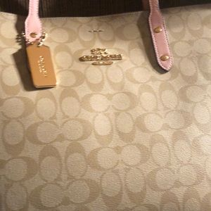Pink/tan Coach leather tote